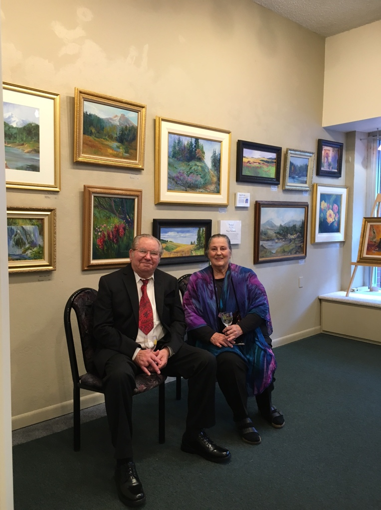 John & Marge Heilman with Marge's paintings
