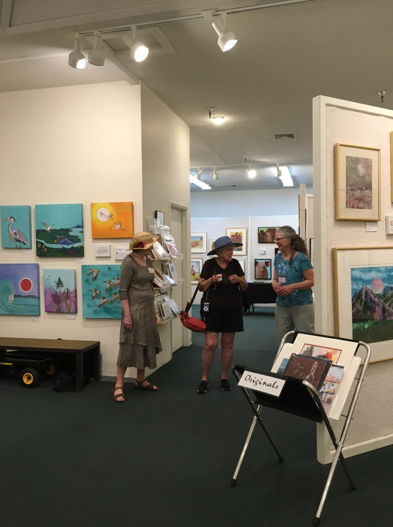 Artist Cathy Egelston talks with gallery visitors
