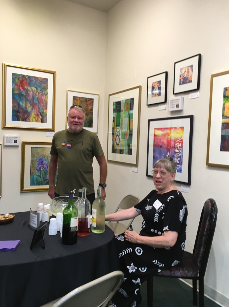 Judy Bjorlie pours wine for a gallery visitor
