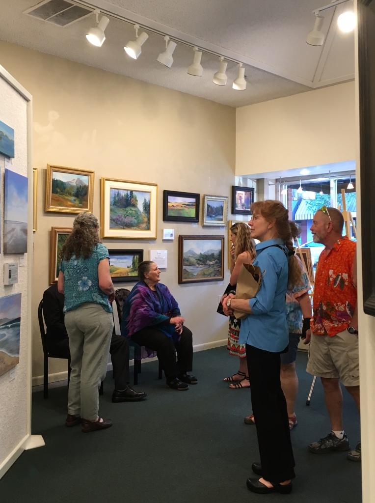 Artist Marge Heilman greats visitors at her reception
